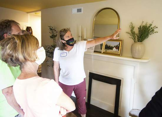 Katie Fyfe   The Journal Gazette Beth Squires talks to guests inside the Mary Rockhill-Tyler house along Van Buren Street during the 39th Annual West Central Neighborhood Home & Garden Tour and ArtsFest on Saturday.