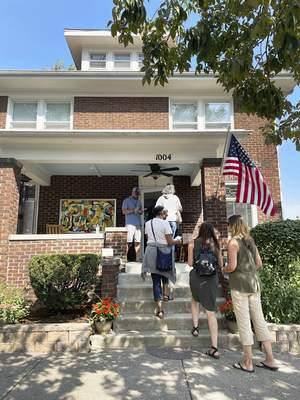 Katie Fyfe   The Journal Gazette People line up to tour a home on Wayne Street during the 39th Annual West Central Neighborhood Home & Garden Tour and ArtsFest on Saturday.