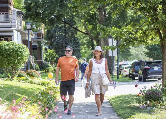 Katie Fyfe   The Journal Gazette Mike and Pam Morgan walk along Wayne Street during the 39th Annual West Central Neighborhood Home & Garden Tour and ArtsFest on Saturday.