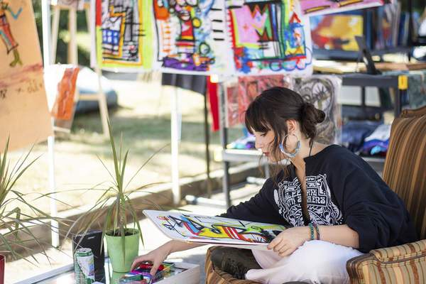 Katie Fyfe   The Journal Gazette Abstract artist Angelina Dolores works on a piece in her booth during the 39th Annual West Central Neighborhood Home and Garden Tour and ArtsFest on Saturday. See related story on Page 1C.
