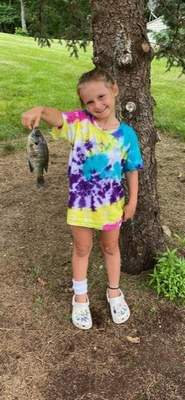 Courtesy photos Lynnlee Lou Werling, 6, of Angola caught this 9-inch bluegill at Big Otter Lake in Steuben County while fishing with her little brother Lawson and Nana and Papa Werling in July.