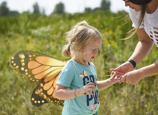 Katie Fyfe | The Journal Gazette Eleanor Colglazier, 4, tries on butterfly wings during the Monarch Festival at Eagle Marsh on Sunday.