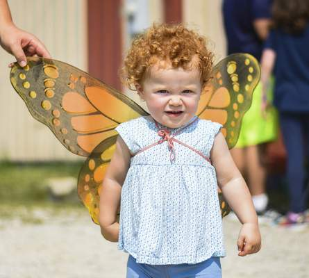 Katie Fyfe | The Journal Gazette Dorothy Colglazier, 1, wears butterfly wings during the Monarch Festival at Eagle Marsh on Sunday.