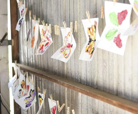 Katie Fyfe | The Journal Gazette Butterfly paintings are hung to dry during the Monarch Festival at Eagle Marsh on Sunday.