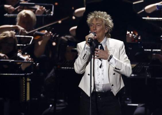 FILE - In this Feb. 18, 2020 file photo, Rod Stewart performs on stage at the Brit Awards 2020 in London. A Florida judge on Thursday, Sept. 9, 2021, has canceled the trial for Stewart and his adult son and scheduled a hearing next month to discuss a plea deal to resolve misdemeanor charges. (Photo by Joel C Ryan/Invision/AP, File)