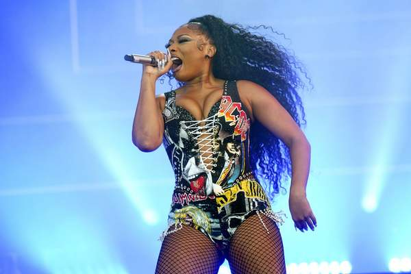FILE - Megan Thee Stallion performs at the Lollapalooza music festival on July 31, 2021 in Chicago. Megan Thee Stallion is nominated for six awards at the 2021 MTV Video Music Awards, airing on Sunday. (Photo by Rob Grabowski/Invision/AP, File)