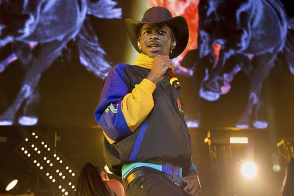FILE - Music artist Lil Nas X performs at HOT 97 Summer Jam in East Rutherford, N. J. on June 1, 2019. The rapper will perform at the 2021 MTV Video Music Awards, airing Sunday night at 8 p.m. EDT. (Photo by Scott Roth/Invision/AP, File)