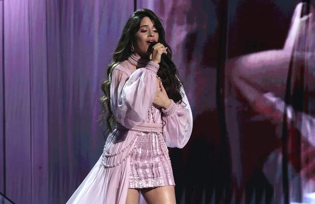 FILE - Camila Cabello performs at the 62nd annual Grammy Awards on Jan. 26, 2020, in Los Angeles. Cabello will perform at the 2021 MTV Video Music Awards, airing Sunday night at 8 p.m. EDT. (Photo by Matt Sayles/Invision/AP, File)