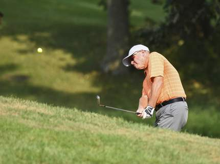 Katie Fyfe | The Journal Gazette Brian Gottwald chips onto the green at the 17th hole during the first round of the Senior City Golf Championship at Orchard Ridge Country Club on Sunday.
