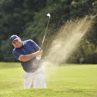 Katie Fyfe | The Journal Gazette Andy Rang hits out of a sand trap at the seventh hole during the final round of the Senior City Golf Championship at Orchard Ridge Country Club on Monday.