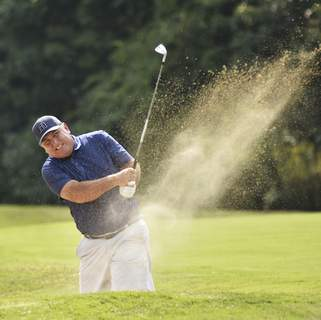 Katie Fyfe   The Journal Gazette Andy Rang hits out of a sand trap at the seventh hole during the final round of the Senior City Golf Championship at Orchard Ridge Country Club on Monday.