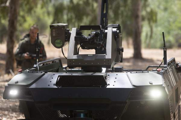 Israel Aerospace Industries' semi-autonomous four-wheel-drive REX MKII is seen at an IAI facility near the central Israeli city of Lod, Thursday, Sept. 9, 2021. Israel's state-owned Israel Aerospace Industries unveiled Monday a state-of-the-art unmanned vehicle their specialists said will be deployed alongside ground troops to assist in combat situations. (AP Photo/Sebastian Scheiner)