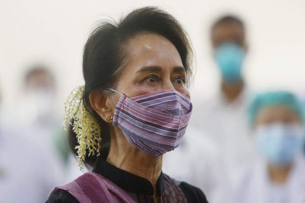 FILE - In this Jan. 27, 2021, file photo, Myanmar leader Aung San Suu Kyi watches the vaccination of health workers at a hospital in Naypyitaw, Myanmar. (AP Photo/Aung Shine Oo, File)