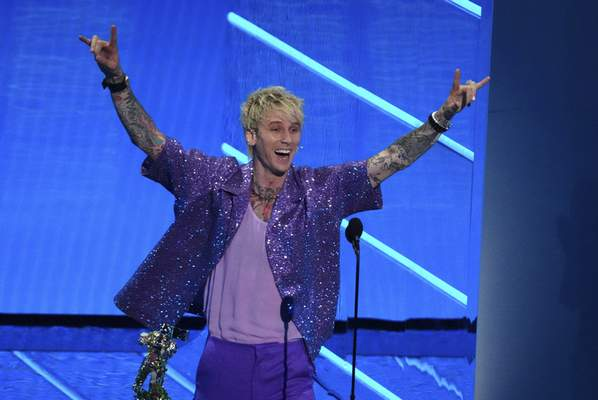 Machine Gun Kelly accepts the award for best alternative song for My Ex's Best Friend at the MTV Video Music Awards at Barclays Center on Sunday, Sept. 12, 2021, in New York. (Photo by Charles Sykes/Invision/AP)