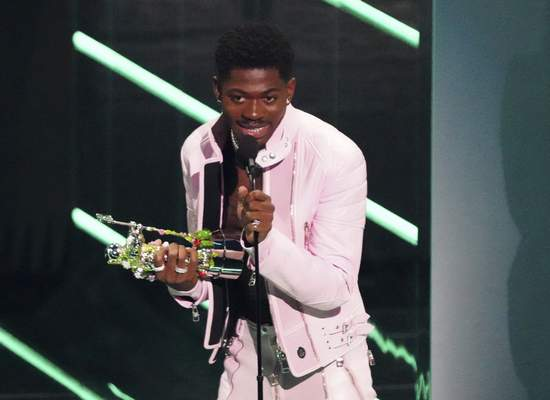 Lil Nas X accepts the award for video of the year for Montero (Call Me By Your Name) at the MTV Video Music Awards at Barclays Center on Sunday, Sept. 12, 2021, in New York. (Photo by Charles Sykes/Invision/AP)