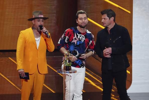 AJ McLean, from left, Lance Bass and Nick Lachey present the award for best K-pop at the MTV Video Music Awards at Barclays Center on Sunday, Sept. 12, 2021, in New York. (Photo by Charles Sykes/Invision/AP)