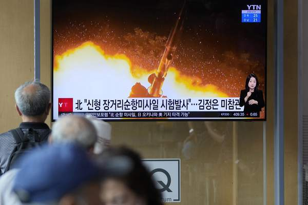 People watch a news program that was showing part of a North Korean handout photo that says, North Korea's long-range cruise missiles tests, in Seoul, South Korea, Monday, Sept. 13, 2021. (AP Photo/Lee Jin-man)