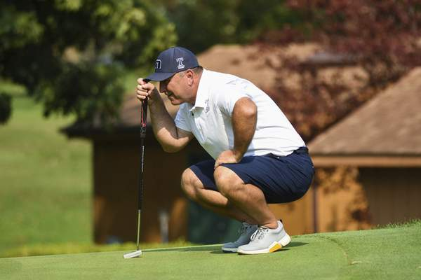 Katie Fyfe | The Journal Gazette Andy Rang prepares to putt at the 17th hole during the first round of the Senior City Golf Championship at Orchard Ridge Country Club on Sunday.