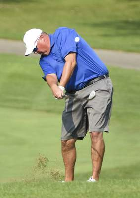 Katie Fyfe | The Journal Gazette Tim Wagner hits from the fairway at the first hole during the first round of the Senior City Golf Championship at Orchard Ridge Country Club on Sunday.