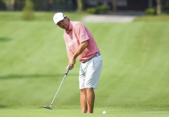 Katie Fyfe | The Journal Gazette  Karl Behrens putts on the first hole during the first round of the Senior City Golf Championship at Orchard Ridge Country Club on Sunday.