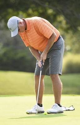 Katie Fyfe | The Journal Gazette  Brian Gottwald putts on the second green during the first round of the Senior City Golf Championship at Orchard Ridge Country Club on Sunday.
