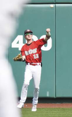Katie Fyfe | The Journal Gazette  TinCaps outfielder Robert Hassell III throws the ball during the third inning against Lansing Lugnuts at Parkview Field on Sunday.
