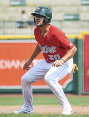 Katie Fyfe | The Journal Gazette  The TinCaps' Justin Lopez watches the Lansing Lugnuts pitcher closely as he begins to take a lead from first base during the second inning at Parkview Field on Sunday.