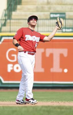 Katie Fyfe | The Journal Gazette  TinCaps infielder Ripken Reyes catches the ball during the third inning against Lansing Lugnuts at Parkview Field on Sunday.