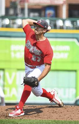 Katie Fyfe | The Journal Gazette The TinCaps' Felix Minjarez delivers a pitch during the first inning against the Lansing Lugnuts at Parkview Field on Sunday.