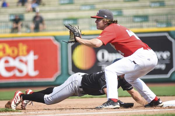 Katie Fyfe | The Journal Gazette  The TinCaps Chris Givin prepares to catch the ball at first base during the third inning against the Lansing Lugnuts at Parkview Field on Sunday.