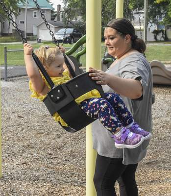 Michelle Davies   The Journal Gazette Cheyanne Brinkert, 2, is all smiles as her mom, Crystal, pushes her on the swing set Monday morning at Hamilton Park.