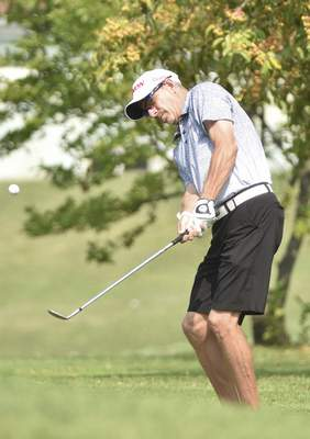 Katie Fyfe | The Journal Gazette David Belville hits onto the green at the second hole during the final round of the Senior City Golf Championship at Orchard Ridge Country Club on Monday. Belville shot a final-round 72 to win the tournament.
