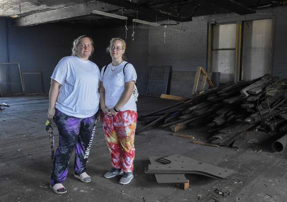 Photos by Michelle Davies | The Journal Gazette Sisters Angelica Ghaster, right, and Stephanie Fromm, members of the Ghost Hunters Society of Fort Wayne, will conduct a ghost hunt Sept. 25 as part of the world's largest ghost hunt in the JW Kidd building. The area shown is reportedly haunted by the former owner, Dr. James W. Kidd, and others.