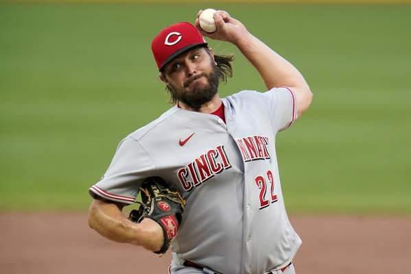 Cincinnati Reds starting pitcher Wade Miley delivers during the first inning of a baseball game against the Pittsburgh Pirates in Pittsburgh, Tuesday, Sept. 14, 2021. (AP Photo/Gene J. Puskar)