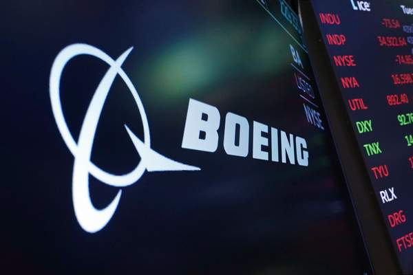 FILE - The logo for Boeing appears on a screen above a trading post on the floor of the New York Stock Exchange, Tuesday, July 13, 2021. (AP Photo/Richard Drew, file)