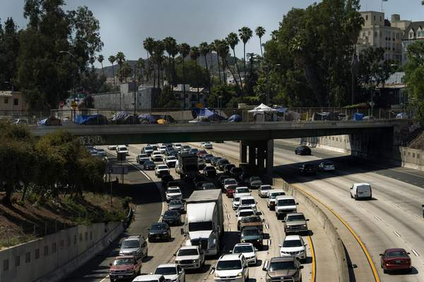 FILE - In this July 7, 2021, file photo homeless encampments are installed on an overpass of the CA-101 Hollywood freeway in Los Angeles. (AP Photo/Damian Dovarganes, File)