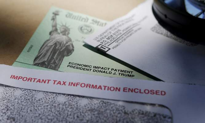 FILE - In this April 23, 2020, file photo, President Donald Trump's name is seen on a stimulus check issued by the IRS to help combat the adverse economic effects of the COVID-19 outbreak, in San Antonio. (AP Photo/Eric Gay, File)