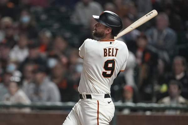 San Francisco Giants' Brandon Belt hits a two-run home run against the San Diego Padres during the fourth inning of a baseball game in San Francisco, Monday, Sept. 13, 2021. (AP Photo/Jeff Chiu)