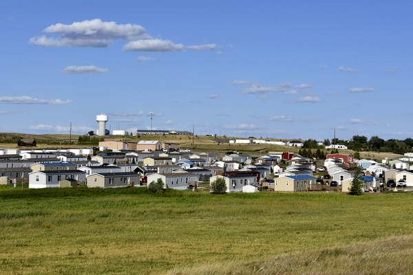 A housing development sits in Aug. 24, 2021, in Watford City, N.D., part of McKenzie County, the fastest-growing county in the U.S. (AP Photo/Matthew Brown)