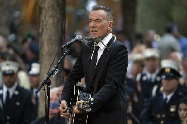 FILE - In this Saturday, Sept. 11, 2021, file photo, Bruce Springsteen performs during ceremonies to commemorate the 20th anniversary of the 9/11 terrorist attacks, at the National September 11 Memorial & Museum in New York. (AP Photo/John Minchillo, File)