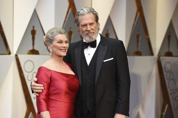 Susan Geston, left, and Jeff Bridges arrive at the Oscars on Sunday, Feb. 26, 2017, at the Dolby Theatre in Los Angeles. (Photo by Jordan Strauss/Invision/AP)