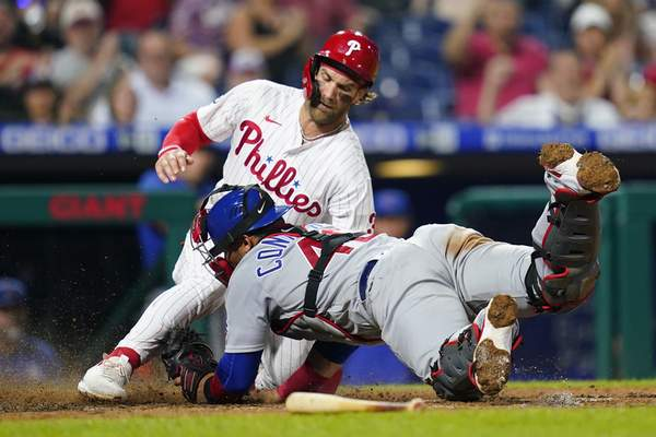 Associated Press Philadelphia's Bryce Harper scores past Chicago Cubs catcher Willson Contreras on a RBI-single by Didi Gregorius during the sixth inning Tuesday in Philadelphia.