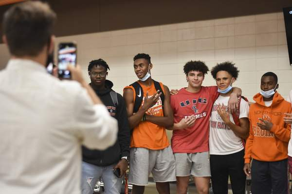 Katie Fyfe   The Journal Gazette North-rop's Jalen Jackson, center, stands with friends who came to hear Jackson say he will attend Illinois Chicago.