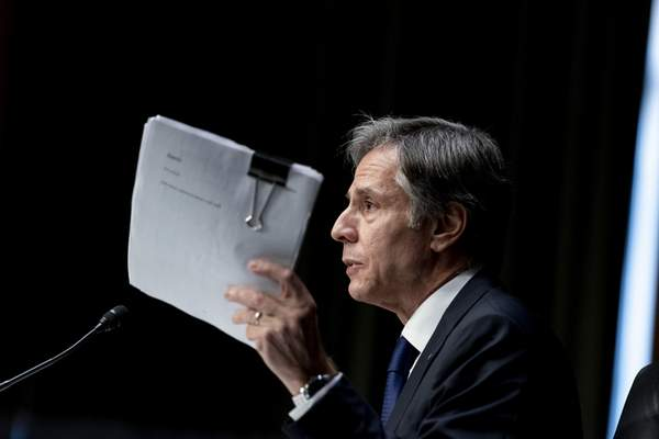 Associated Press Secretary of State Antony Blinken holds up documents Tuesday while speaking at a Senate committee hearing on the U.S. withdrawal from Afghanistan.