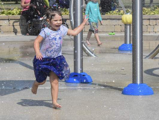 Michelle Davies   The Journal Gazette Sophia James, 2, of Fort Wayne runs through the splash pad at Kreager Park on a hot Tuesday afternoon.