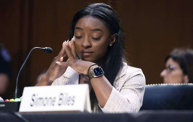 United States Olympic gymnast Simone Biles testifies during a Senate Judiciary hearing about the Inspector General's report on the FBI's handling of the Larry Nassar investigation on Capitol Hill, Wednesday, Sept. 15, 2021, in Washington. (Saul Loeb/Pool via AP)