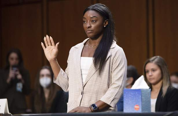 United States Olympic gymnast Simone Biles is sworn in during a Senate Judiciary hearing about the Inspector General's report on the FBI's handling of the Larry Nassar investigation on Capitol Hill, Wednesday, Sept. 15, 2021, in Washington. (Saul Loeb/Pool via AP)