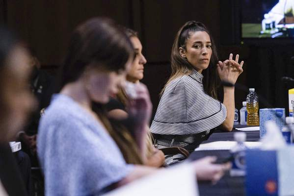 United States gymnasts from left, Simone Biles, McKayla Maroney, Maggie Nichols, and Aly Raisman testify during a Senate Judiciary hearing about the Inspector General's report on the FBI's handling of the Larry Nassar investigation on Capitol Hill, Wednesday, Sept. 15, 2021, in Washington. (Graeme Jennings/Pool via AP)