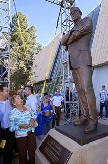 Obit Nan Wooden FILE - In this Oct. 26, 2012, file photo, Nan Wooden looks at a statue of her late father, UCLA men's basketball coach John Wooden, after its unveiling outside the new Pauley Pavilion at UCLA in Los Angeles. Nan Wooden died Tuesday, Sept. 14, 2021. She was 87. The school said she died of natural causes at a care facility in the San Fernando Valley, according to family members. She had suffered a series of strokes in recent years. (AP Photo/Mark J. Terrill, File) (Mark J. Terrill STF)