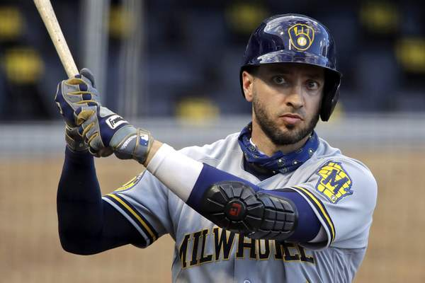 FILE - In this July 28, 2020, file photo, Milwaukee Brewers' Ryan Braun warms up on deck during the first inning of a baseball game against the Pittsburgh Pirates in Pittsburgh. Braun, the Brewers' home run leader whose production was slowed by injuries during the second half of his 14-year career, announced his retirement on Tuesday, Sept. 14, 2021. Braun hasn't played all season and said during spring training that he was leaning toward retirement. (AP Photo/Gene J. Puskar, File)